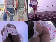 G-string upskirt footage of a hot auburn haired gal