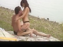 Horny couple in river beach shore caught fucking