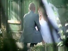 Bride caught with man peeing outdoors