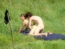 Naturist couple having sex in the river shore