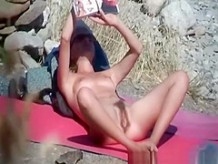 Hairy pussy nudist woman reading book