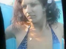 Busty milf in beach cabine